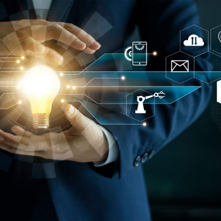 Business innovation technologies concept. Businessman' s hand holding glowing light bulb with icon technology network connection. Futuristic digital marketing and innovative development on modern interface background.